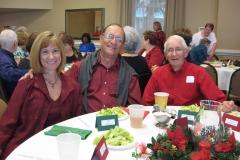 Linda & Bill Vivian and Dick Silvernail enjoying the Christmas party